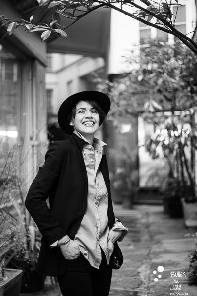Portrait of a woman in a parisian passage. Portrait to illustrate the blog post: Personal Branding Portrait Session in Paris by Bulles de Joie, portrait photographer paris. See more at: