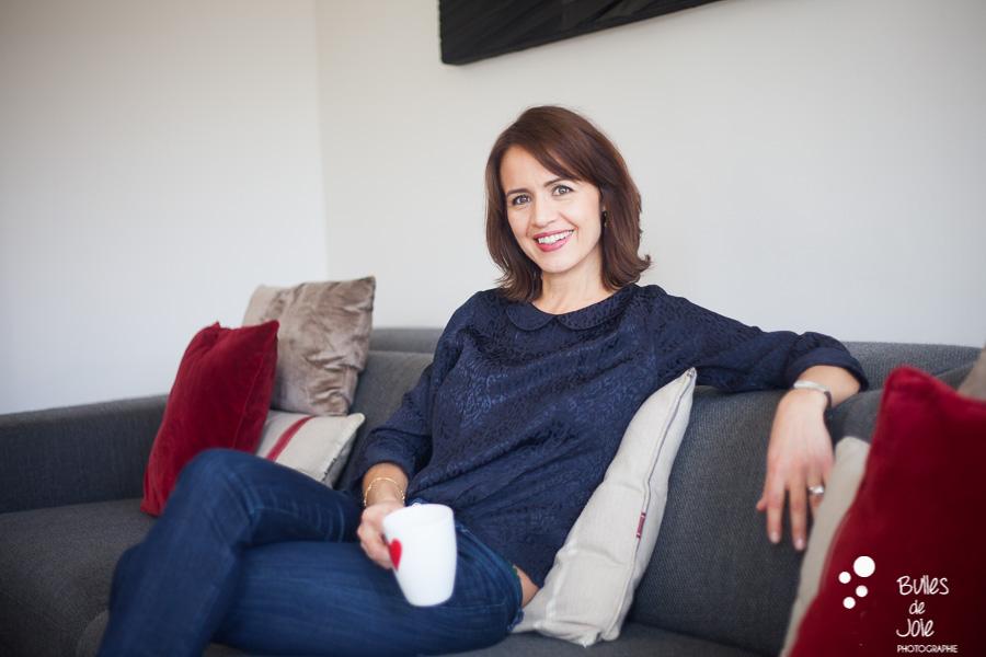 Woman on her living room. Portrait to illustrate the blog post: Personal Branding Portrait Session in Paris by Bulles de Joie, portrait photographer paris. See more at: