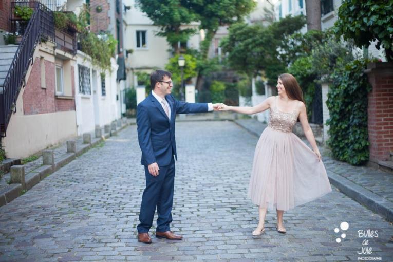 Couple dancing in a parisian street. Private photo shoot Paris captured at Montmartre by Bulles de Joie, professional paris photographer. More photos: