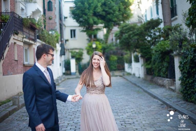 A woman smiling at her man. Private photo shoot Paris captured at Montmartre by Bulles de Joie, professional paris photographer. More photos: