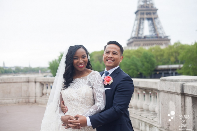 Couple in front of the Eiffel Tower on their wedding day. More photos: