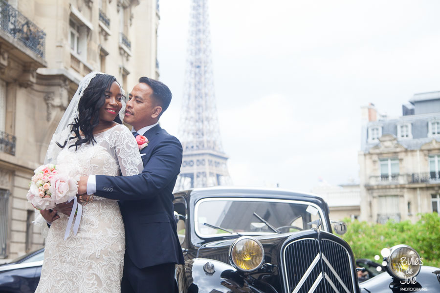 Bride and groom during their elopement photo session, in front of their traction and the Eiffel Tower. More photos: