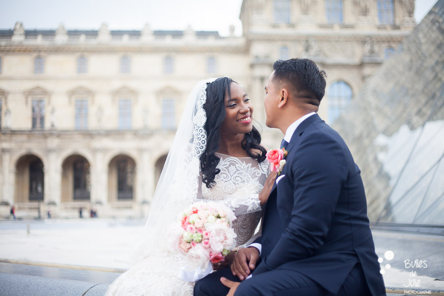 Elopement in Paris at the Louvre - bride and groom looking at each other with love. More photos: