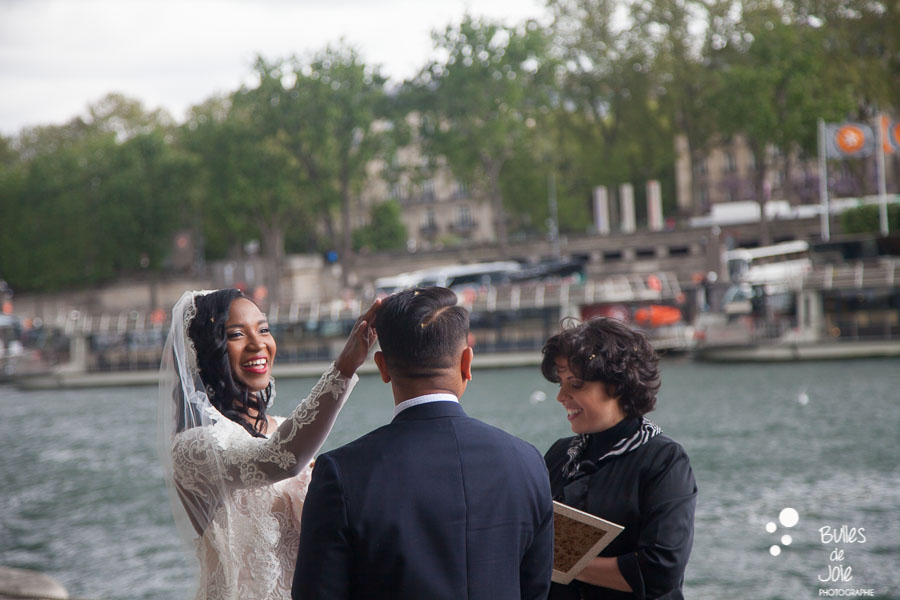 Elopement in paris - Woman smiling at her men while touching his hair. More photos: