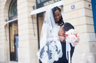 Elopement in Paris at PLace Vendome - bride and groom looking at each other with love. More photos: