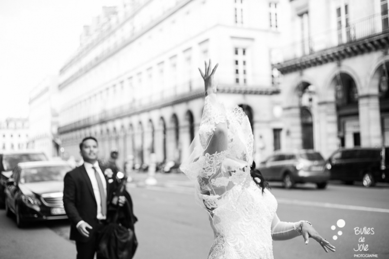 Bride and groom having fun. Bouquet launch at the end of a parisian elopement. More photos: