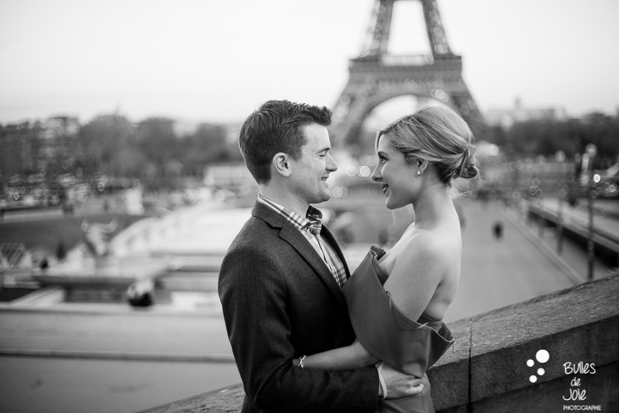 happy couple in front of the eiffel tower
