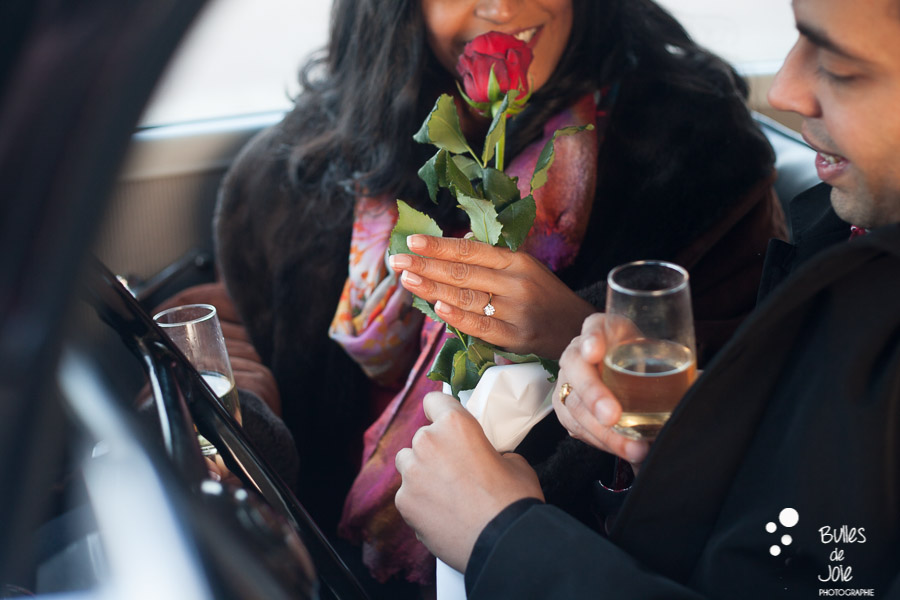 Romantic surpise proposal in Paris with champagne and rose in a vintage car | By Bulles de Joie, engagement photographer in Paris | See more at: https://www.bullesdejoie.net/2017/01/09/surprise-proposal-bir-hakeim-paris-eiffel-tower/