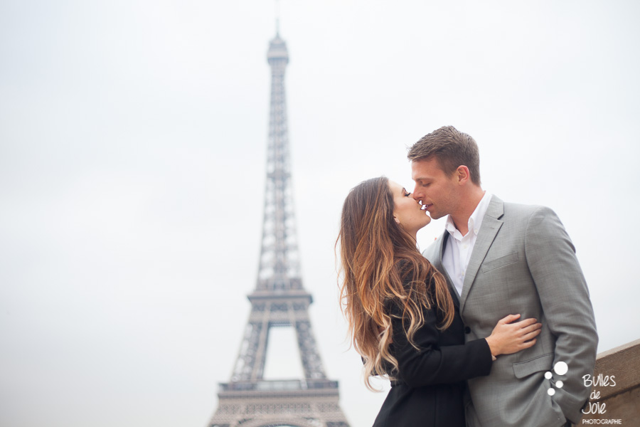 Lovers kissing, with the Eiffel Tower in the backgroud. More photos of this love session paris at the following link: