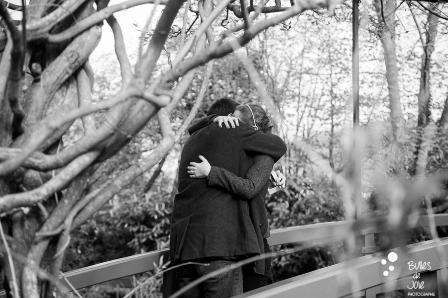 Woman and man in each other arms. Proposal Monet's garden (black and white). More photos of the proposal at: https://www.bullesdejoie.net/2017/04/25/romantic-proposal-monets-garden-giverny-france/