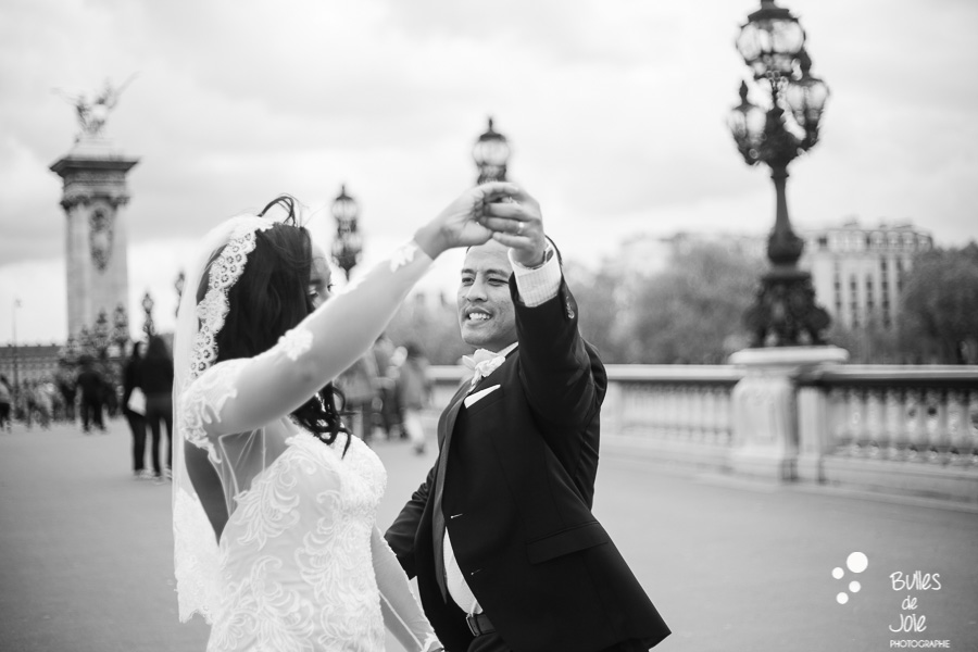 Elopement in Paris. Bride and groom dancing on Alexander 3 bridge. BLack and white photo. More photos: