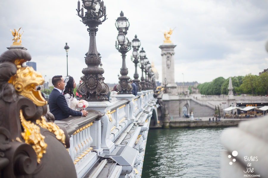 Couple admiring the view, the Eiffel Tower, from Alexander 3 brige