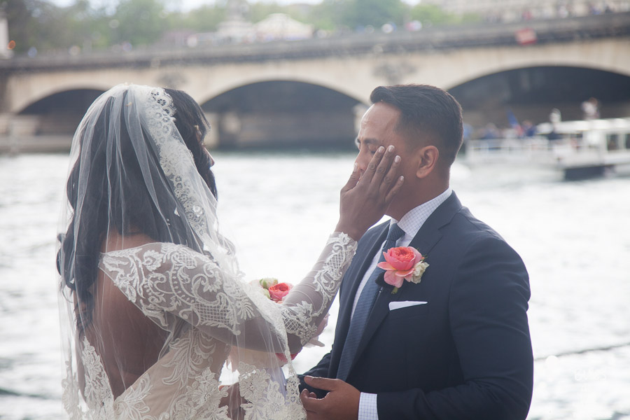 Elopement ceremony in Paris: woman wiping the tears from her husband. More photos: