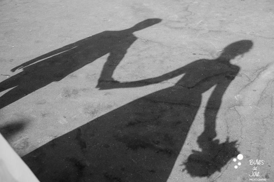 Shadow of a bride and a groom holding their hands in Paris. More photos: