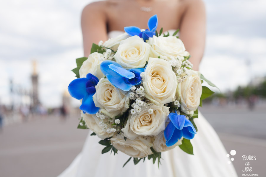 Bridal bouquet, white and blue flowers, captured by Bulles de joie on Alexander 3 bridge. More photos: