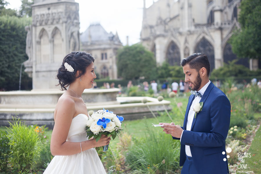 Eloping in Notre-Dame. Man reading his vows to her wife. More photos: