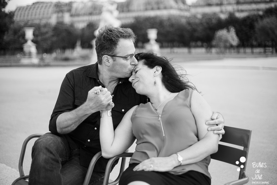 A woman and her husband celebrating their 25th wedding anniversary by capturing their love during a photoshoot in Paris. More photos: https://www.bullesdejoie.net/en/2017/07/13/paris-love-session-25th-anniversary/