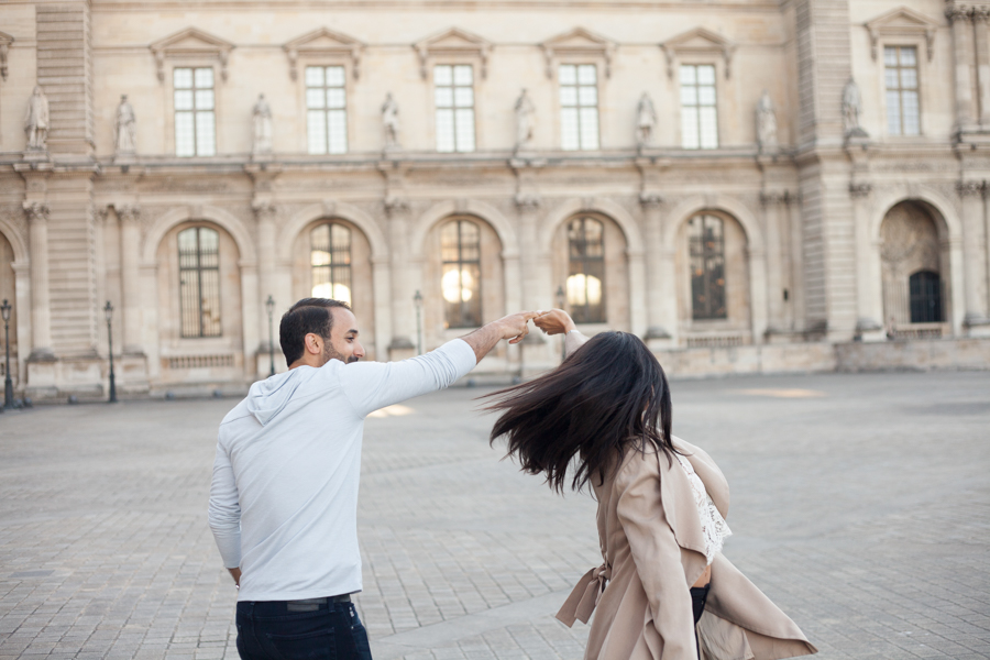 A man making her wife dancing. Photo captured by Bulles de Joie, Engagement & family photographer in Paris.