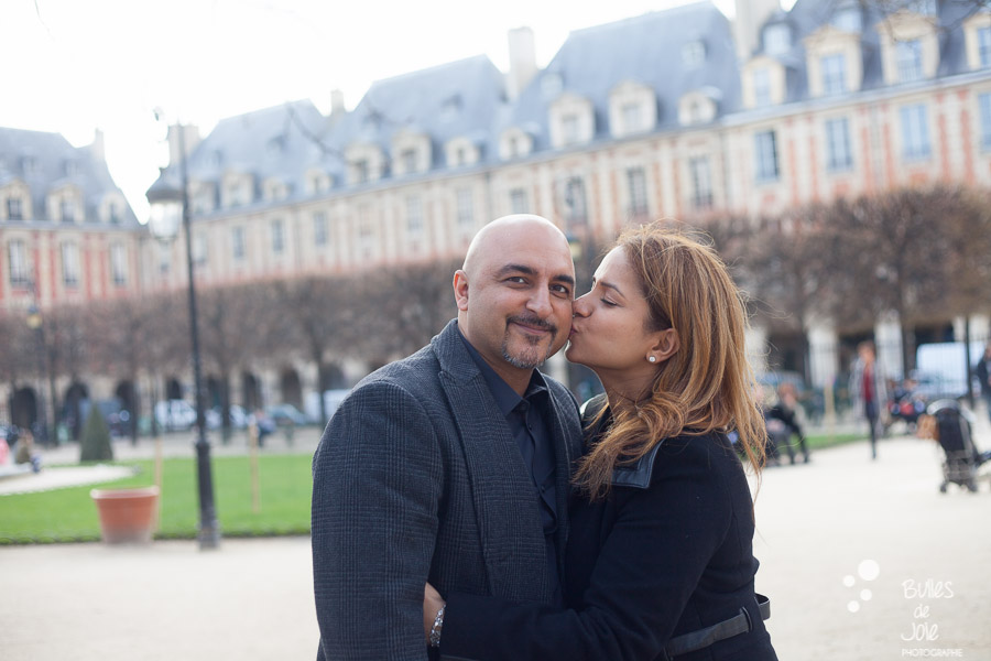 A woman kissing her man on his cheek. Couple photoshoot in Paris. More photos: