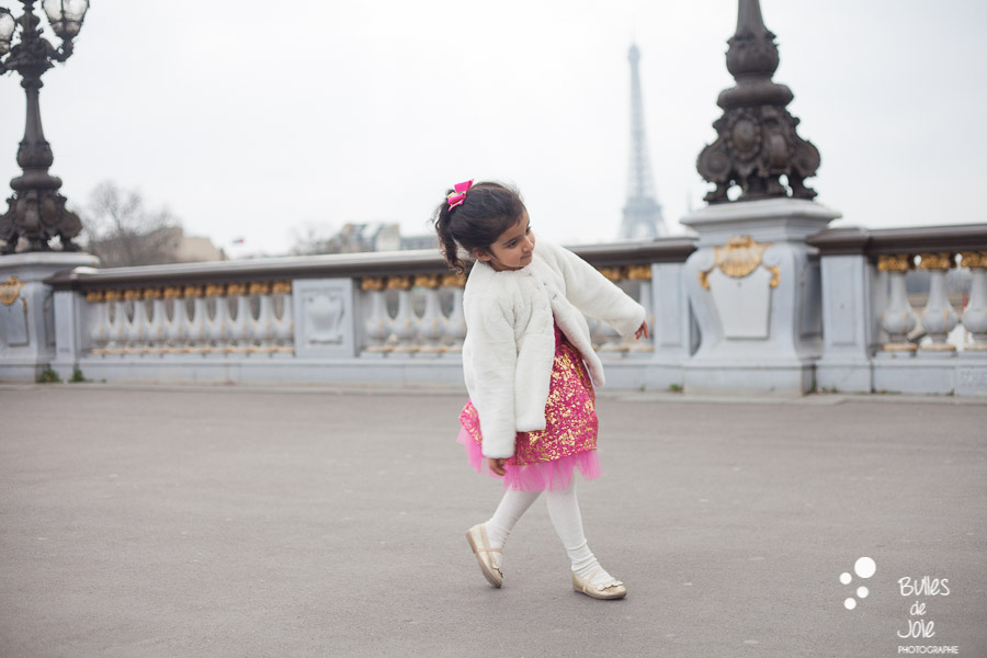 Little girl dancing on the Alexander 3 bridge, with the Eiffel Tower in the backgroud. More photos: