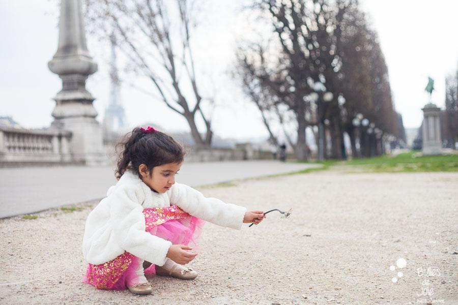 Little girl playing in Paris. Portrait captured by Bulles de Joie on a paris family photoshoot. More photos: