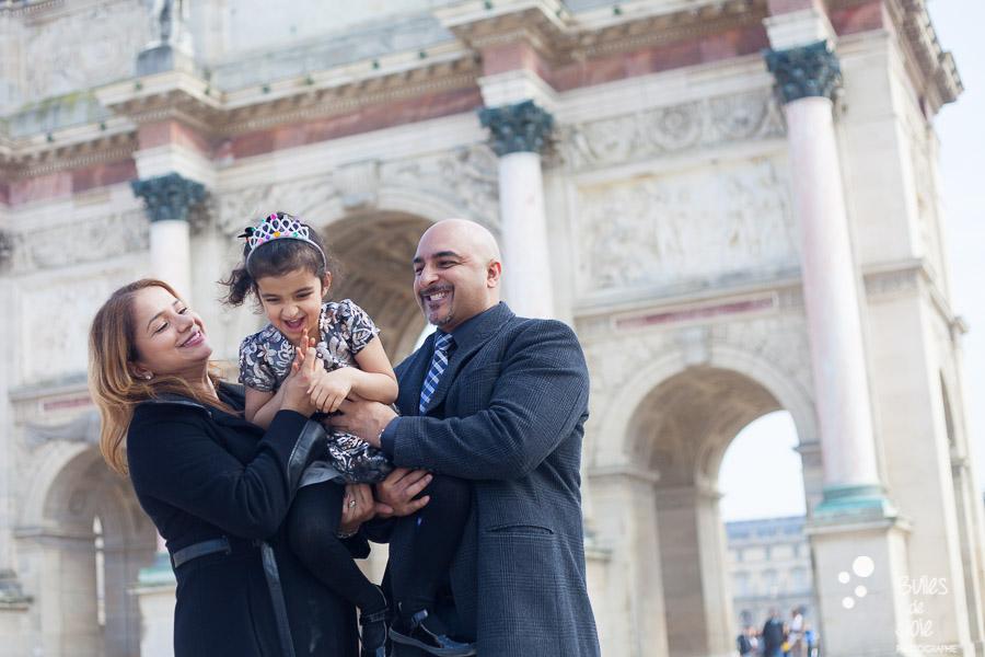 Paris family photo session. Parents holding their little girl. Captured by Bulles de Joie. More photos: