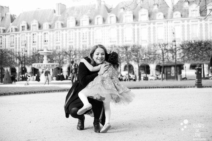 Little girl jumping in her mom's arms. Captured by Bulles de Joie. More photos: