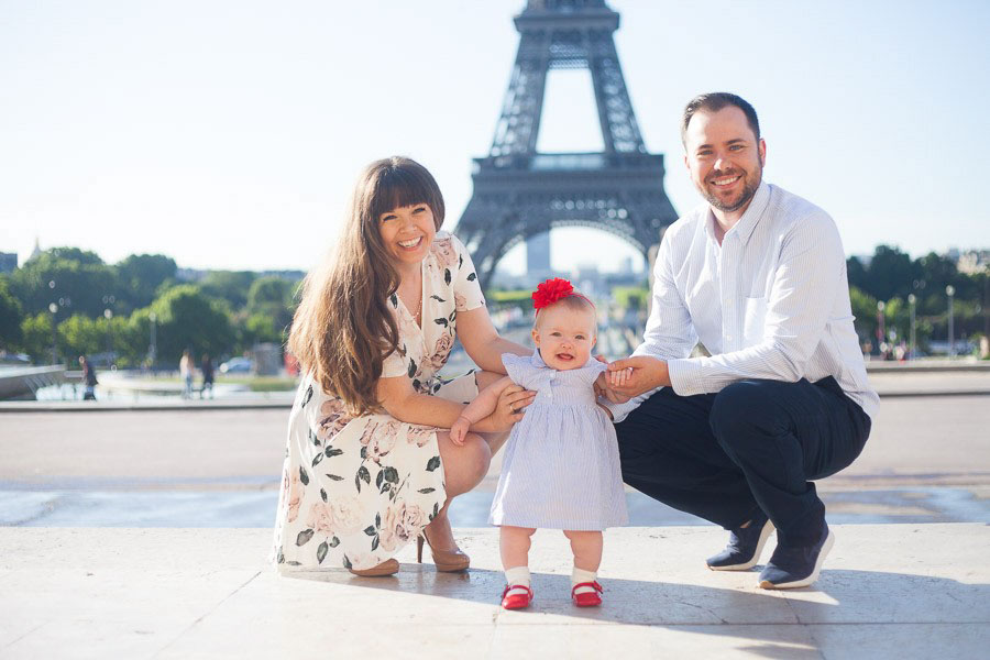 Family portraits at Trocadero in Paris, France. Outside photoshoot in Paris in front of the Eiffel Tower. Captured by Bulles de Joie, Paris family photographer.