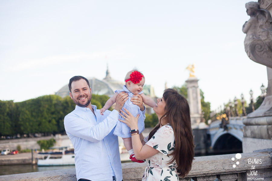 Paris family photoshoot with a toddler of 9-month years old with Alexander 3 bridge in the background - professional photographer: Bulles de Joie. More photos: