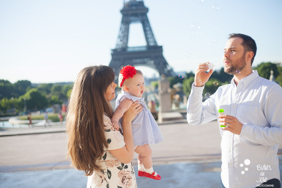 Paris family photoshoot with a toddler of 9-month years old in front of the Eiffel Tower - professional photographer: Bulles de Joie. More photos: