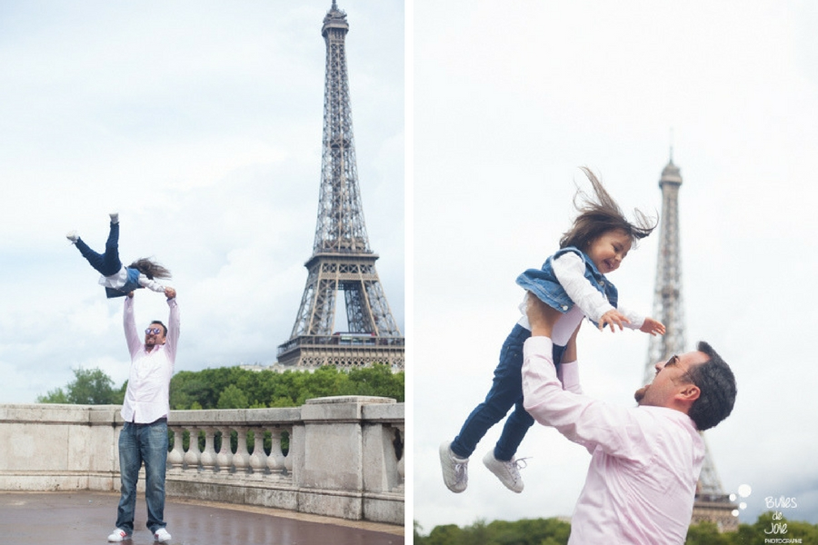 Eifel Tower family photoshoot. A dad making her little girld fly into the air. More photos from Bulles de Joie, paris photographer: https://www.bullesdejoie.net/en/2017/09/14/eifel-tower-family-photoshoot-family-s/