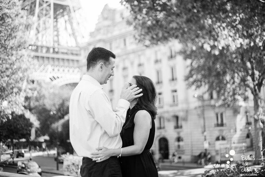 Couple kissing in front of the Eiffel Tower. Romantic couple photoshoot in Paris. Wedding anniversary gift for her. More photos: