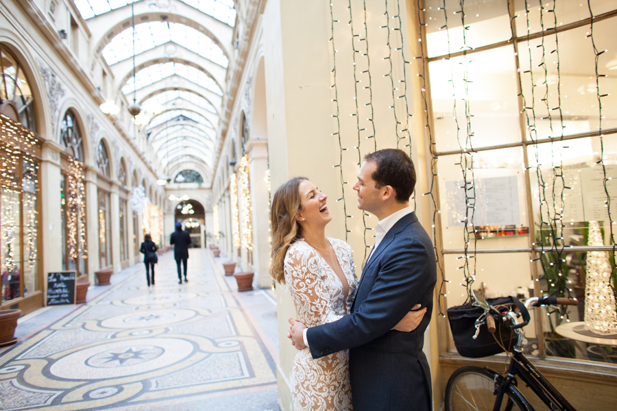 Couple in a beautiful covered parisian gallery. Photo illustrating a blog post about 5 nice places around Paris for a family or engagement photo session.