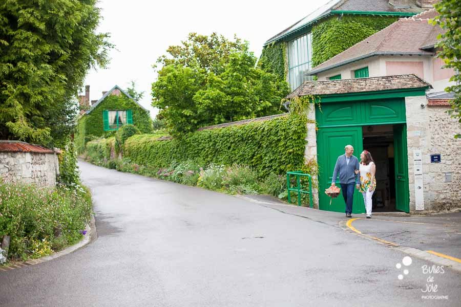 Proposal & engagement photo session in Giverny, lovers leaving Monet's Garden