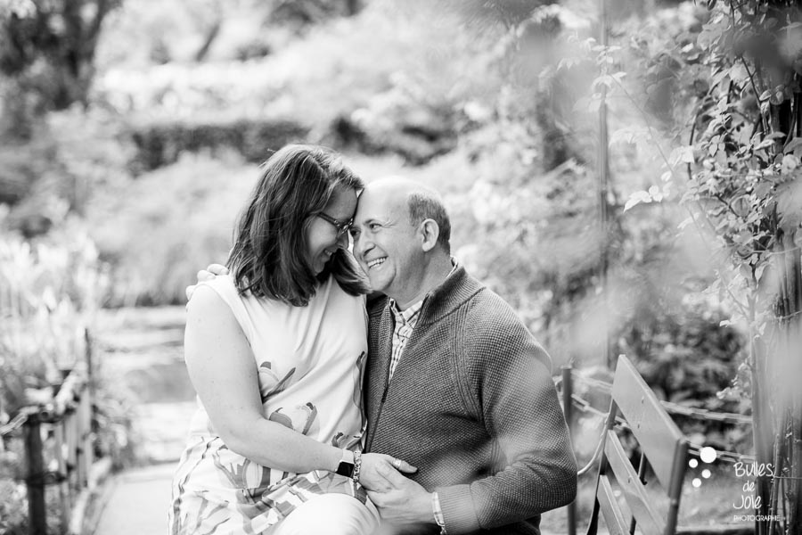 Proposal & engagement photo session in Giverny, lovers on a bench at Monet's garden