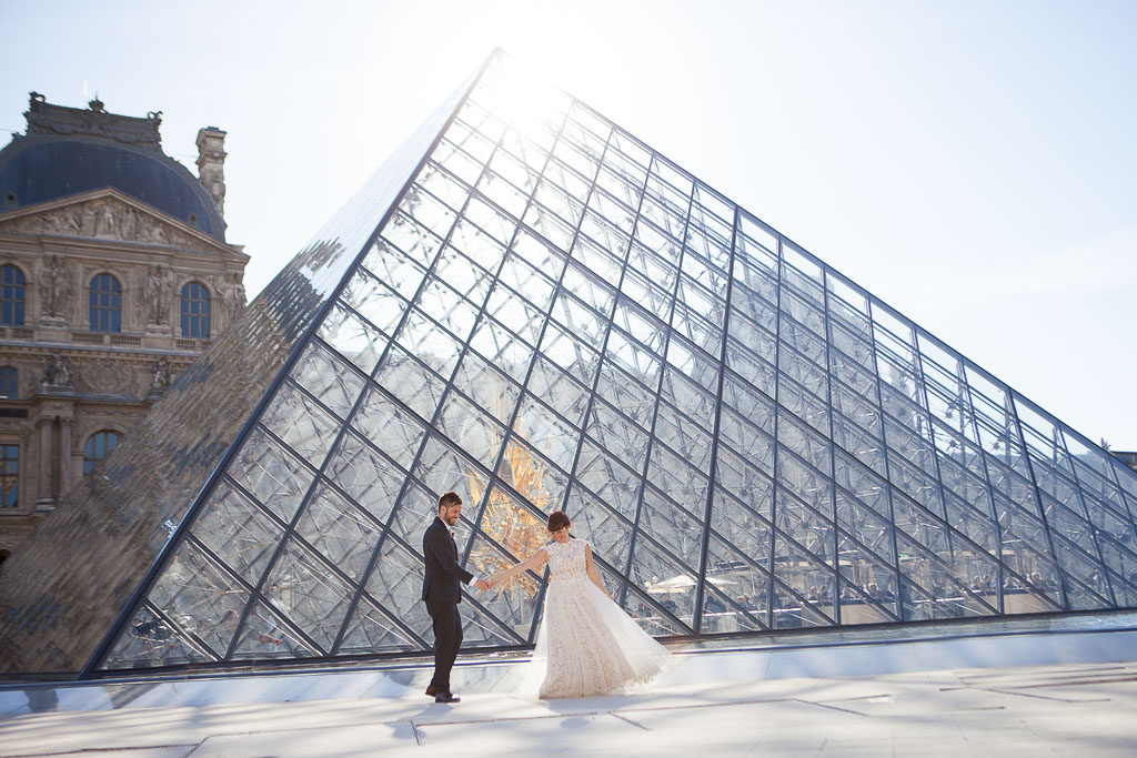 Vow renewal photoshot after the ceremony, Louvre Pyramid in Paris