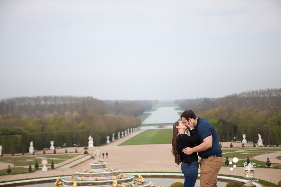 Kiss between lovers at Versailles Gardens, right after the proposal