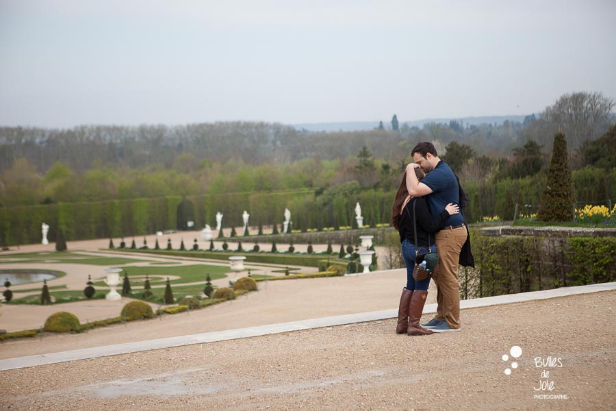 Right before the surprise proposal in Versailles - by Bulles de Joie, Paris Engagement Photographer