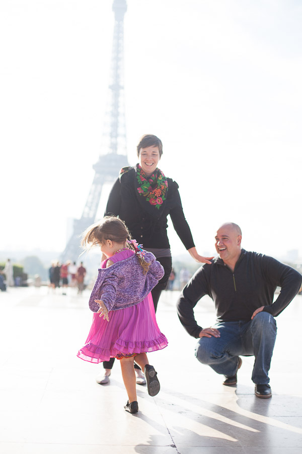 Little girl happy to see the Eiffel Tower and dancing.