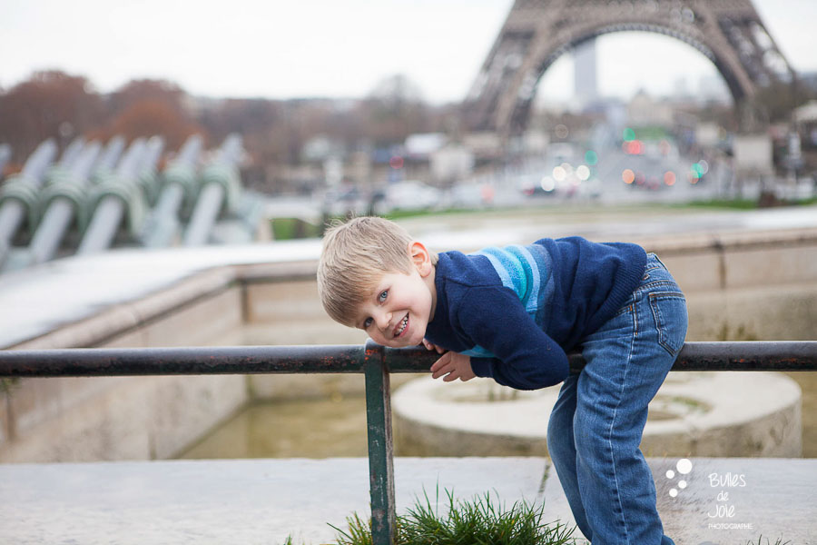 Candid picture of a boy in front of the Eiffel Tower, France