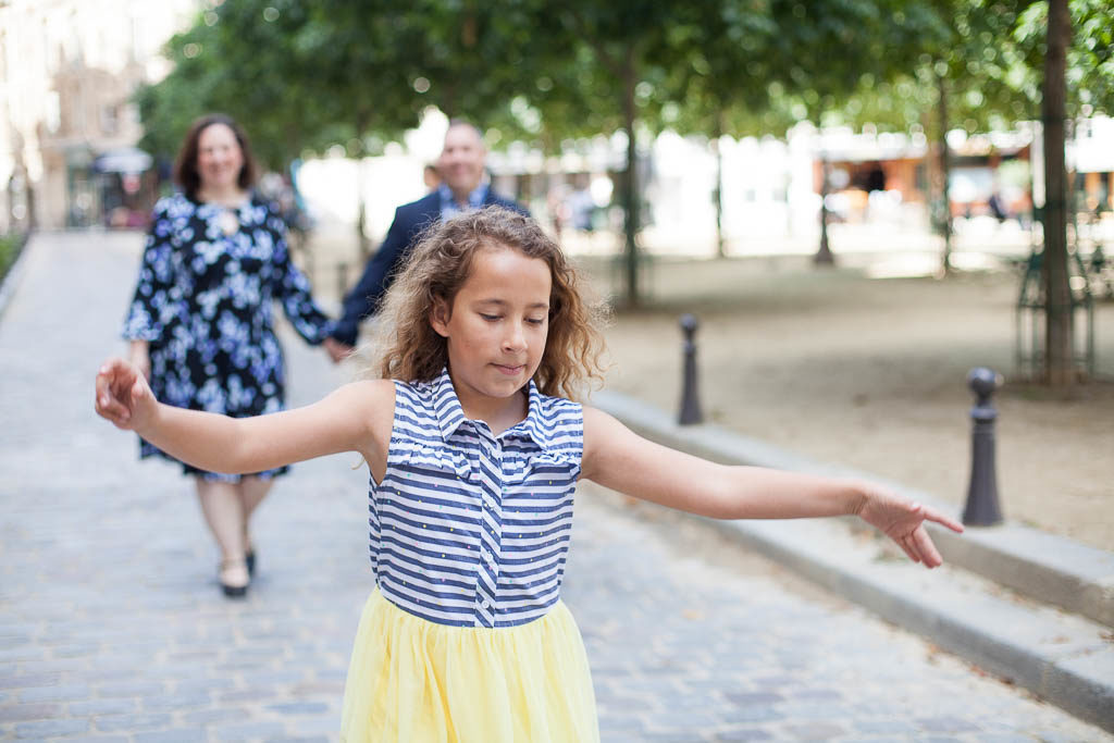 Girl having fun at place Dauphine - Family photoshoot in Paris by Bulles de Joie
