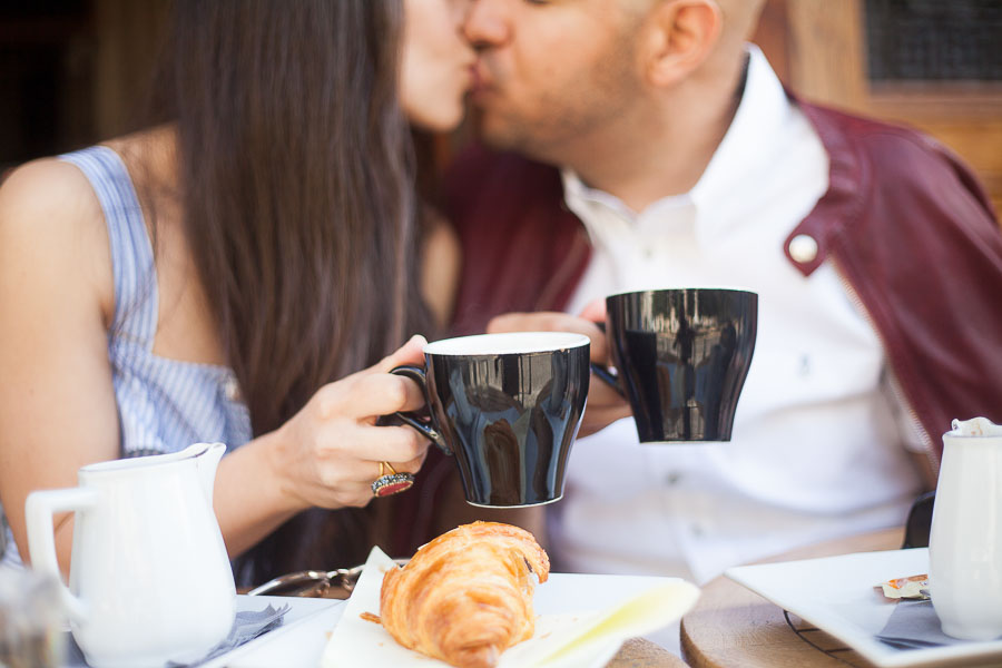 Couple kissing at a cafe