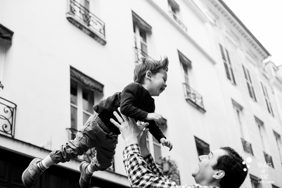Boy flying into the air - Paris family photoshoot by Bulles de Joie