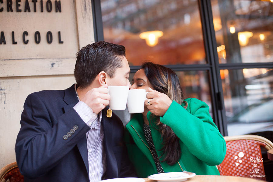 Kiss under the cups at a parisian cafe - love photo session in Paris