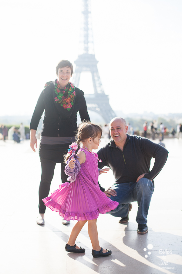 Candid family photoshoot in Paris with the Eiffel Tower in the background